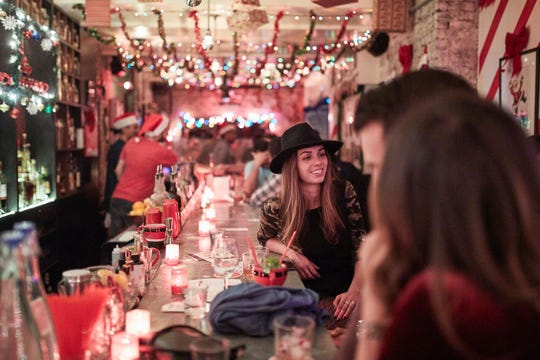 Guests of Miracle on 9th Street chat at the New York City Bar. The bar kicked off the Miracle pop-up concept, which has expanded to about 80 cities in 2018, including Knoxville.