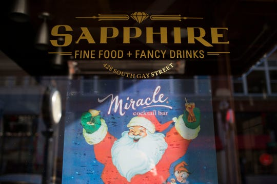 The beginning of Christmas decorations adorn Sapphire on Gay Street Wednesday, Nov. 21, 2018. Sapphire is transforming into a Christmas pop-up bar from Black Friday until Dec. 30.