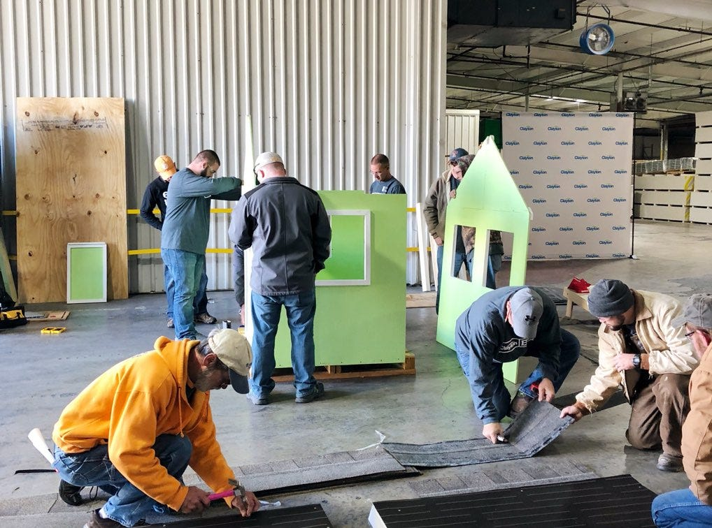 TRU Homes' team members volunteer their spare time to finish one of the playhouses made in the construction class at Gibbs High School. Lacey Mellott, special events coordinator for Habitat, said the initiative is a great team-building opportunity for local businesses.