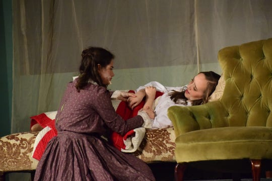 """Back home in Concord, Jo (Jordan Parker) tends to Beth (Tori Hart) as she lies dying in  """"Little Women,"""" a Hardin Valley Academy production Sunday, Nov. 18."""