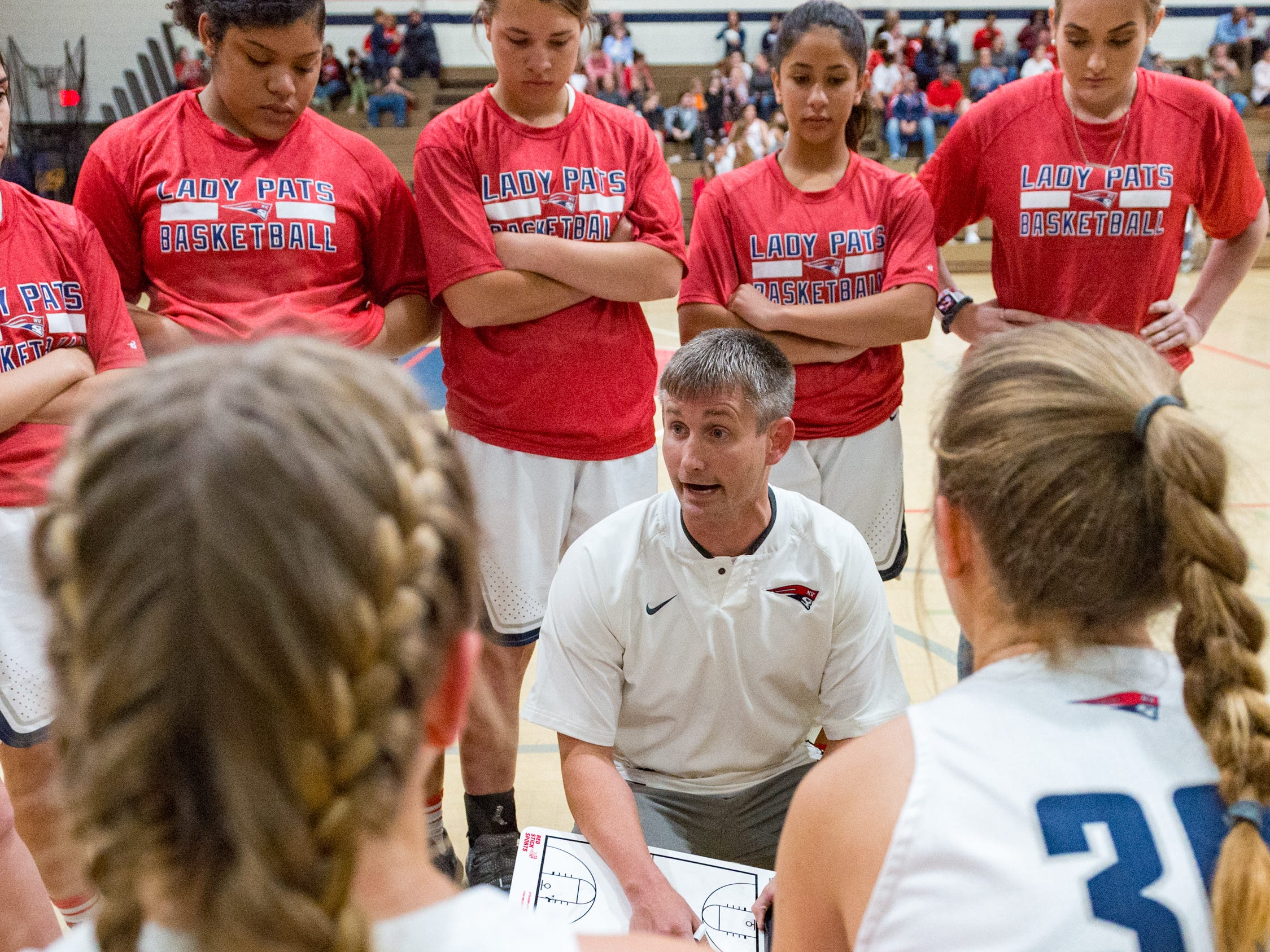 Patriots Head Coach Casey Meador talks to his team during a time out as Notre Dame and North Vermillion face off in Girls Basketball Tournament at North Vermillion High School. Tuesday, Nov. 20, 2018.