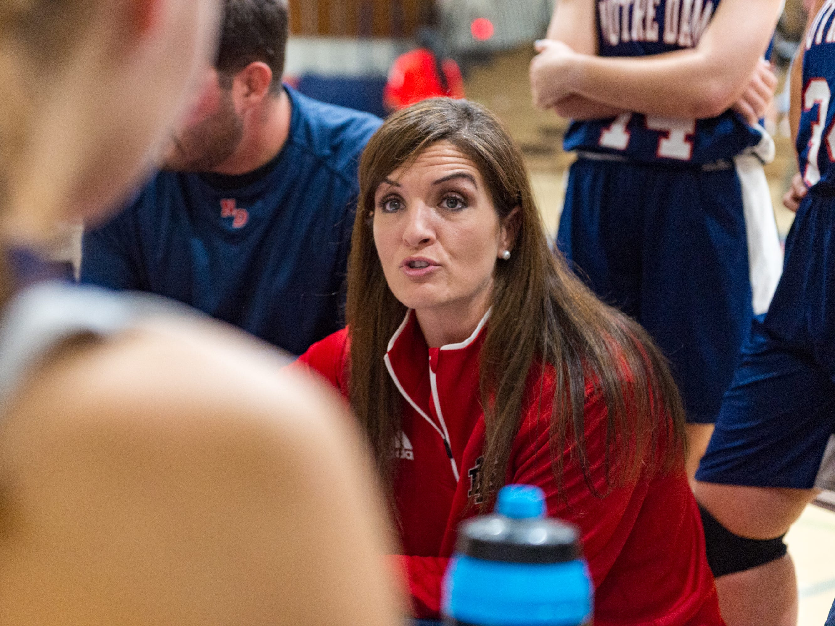 Pios Asst Coach Angie Herbert talks with players during a time out as Notre Dame and North Vermillion face off in Girls Basketball Tournament at North Vermillion High School. Tuesday, Nov. 20, 2018.