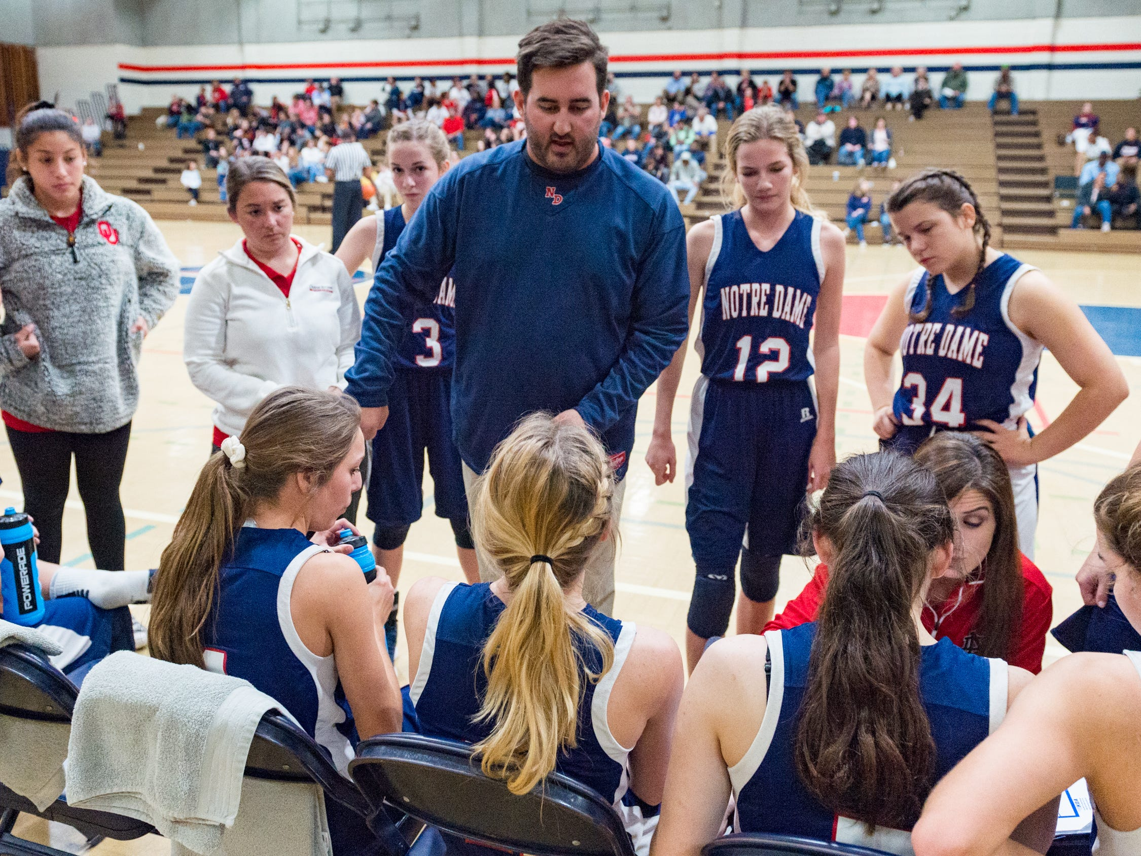 Pios Head Coach Tim Miguez talks to his team during a time out as Notre Dame and North Vermillion face off in Girls Basketball Tournament at North Vermillion High School. Tuesday, Nov. 20, 2018.