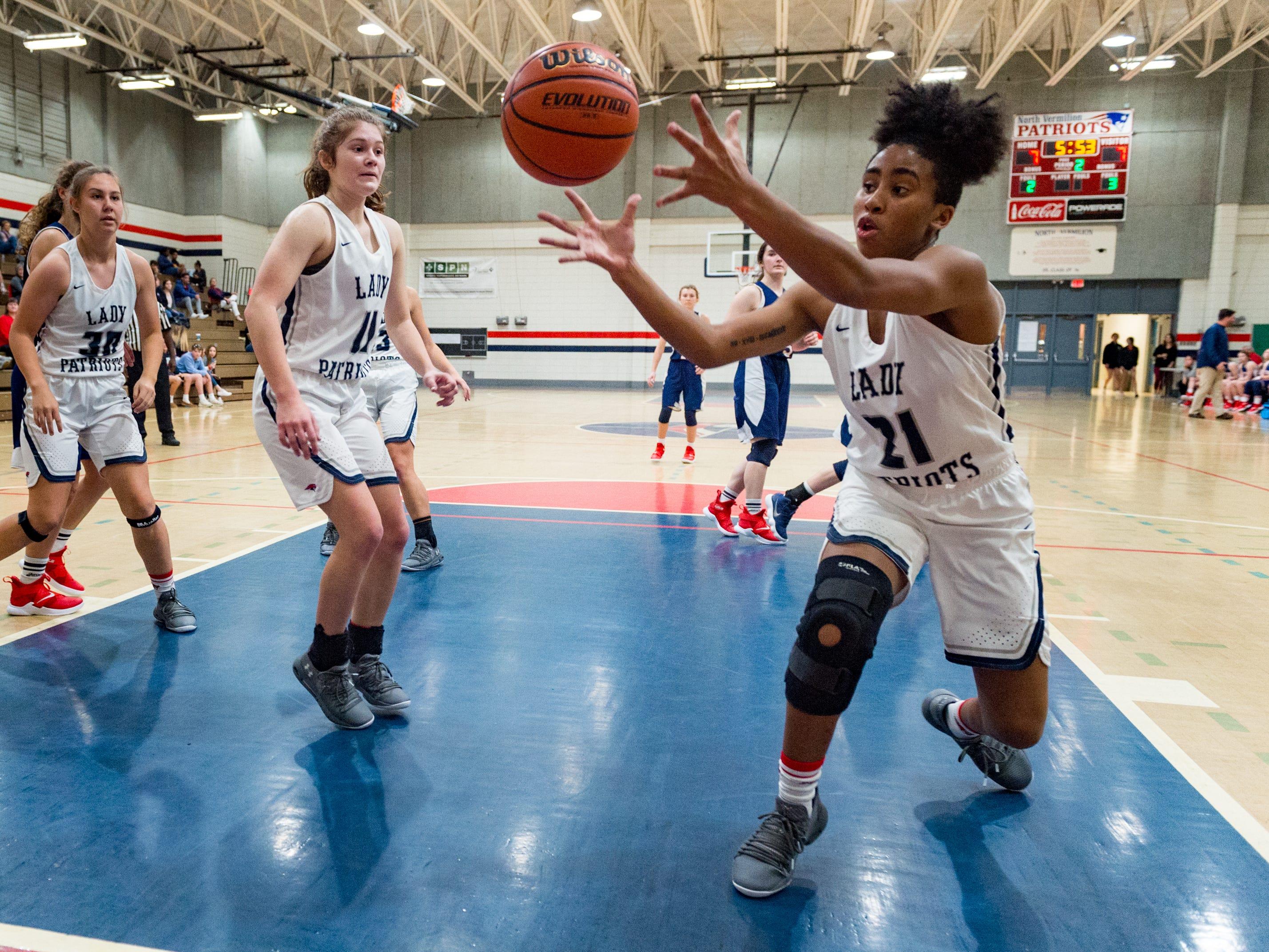 Gabbie Bessard gets the rebound as Notre Dame and North Vermillion face off in Girls Basketball Tournament at North Vermillion High School. Tuesday, Nov. 20, 2018.