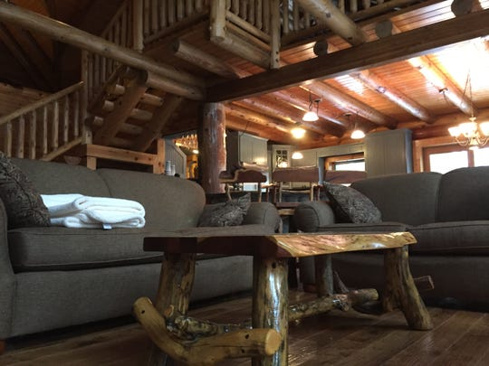 The coffee table in the living room of a Hartland Township log cabin home is one of several matching hand-crafted pieces of furniture, shown Wednesday, Nov. 21, 2018.