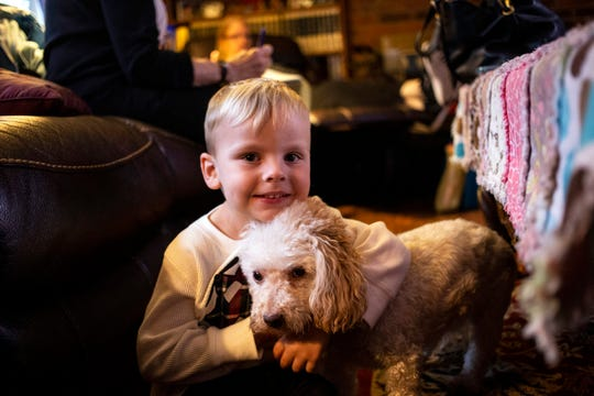 Three-year-old David William Saleh has a friend in little dog Susie.