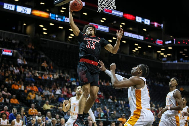 Louisville Cardinals forward Jordan Nwora (33) goes up for a slam dunk in the first half against the Tennessee Volunteers during the NIT Tipoff at Barclays Center in Brooklyn, New York, on Wednesday, Nov. 21, 2018.