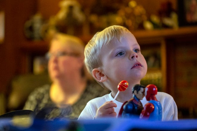 David William Saleh plays with his toys while watching TV in the home of his grandparents.