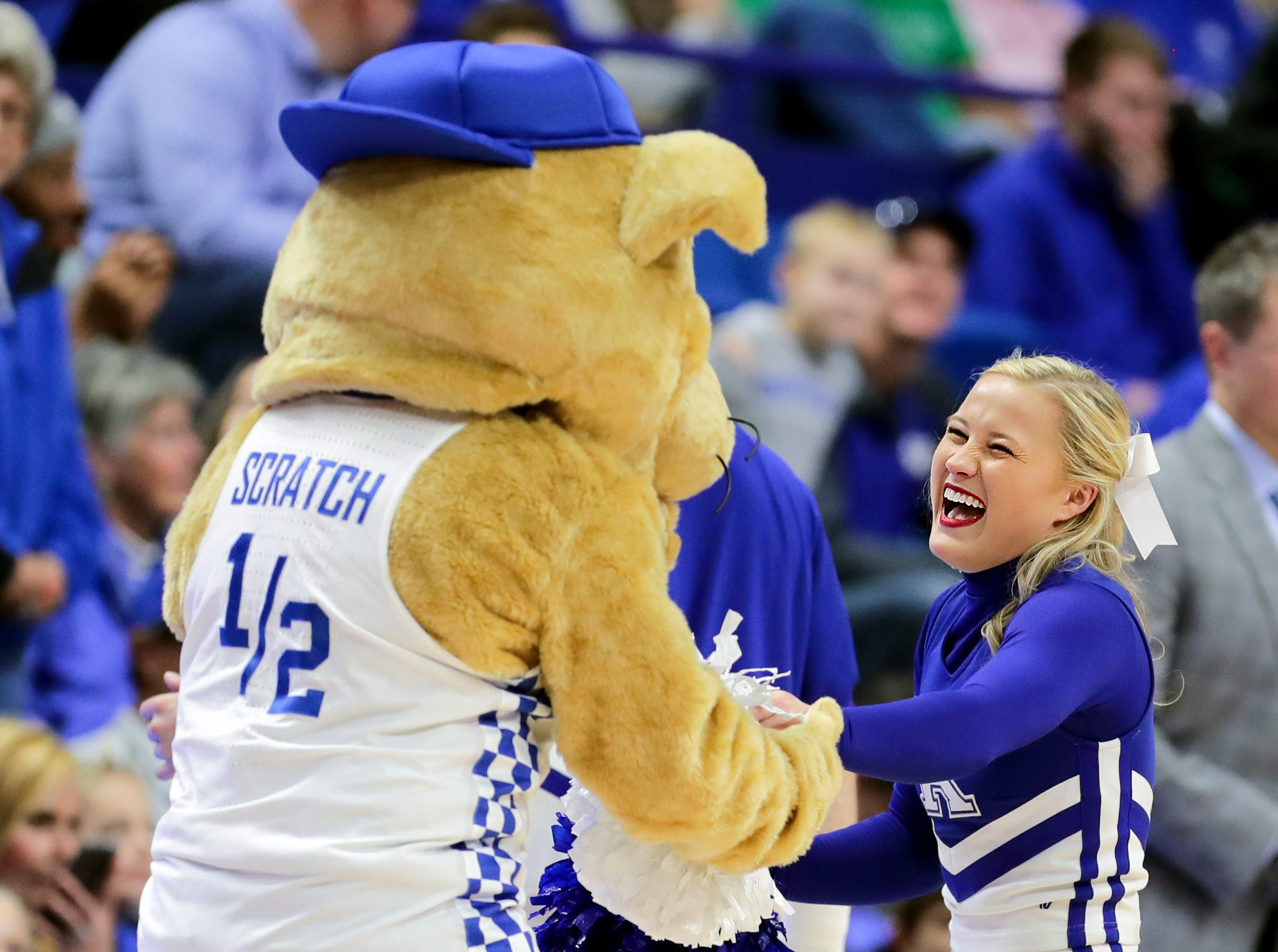 Kentucky's Scratch dances with a member of the cheer squad.  Nov. 21, 2018