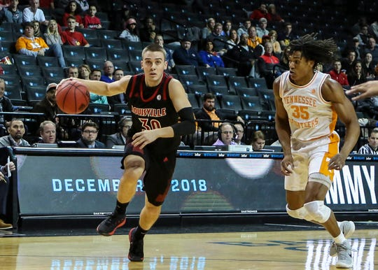 Louisville Cardinals guard Ryan McMahon (30) drives past Tennessee Volunteers guard Yves Pons (35) in the first half against the during the NIT Tipoff at Barclays Center in Brooklyn, New York, on Wednesday, Nov. 21, 2018.