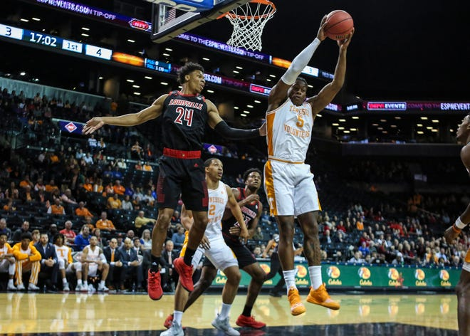 Tennessee Volunteers guard Admiral Schfield (5) grabs a rebound in the first half against the Louisville Cardinals during the NIT Tipoff at Barclays Center in Brooklyn, New York, on Wednesday, Nov. 21, 2018.