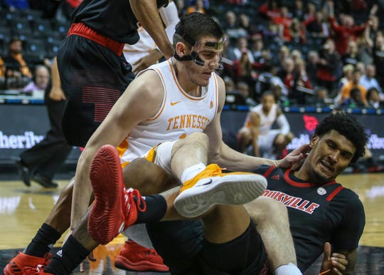Tennessee Volunteers forward John Fulkerson (10) collides with Louisville Cardinals forward Malik Williams (5) in the first half during the NIT Tip Off at Barclays Center in Brooklyn, New York, on Wednesday, Nov. 21, 2018.