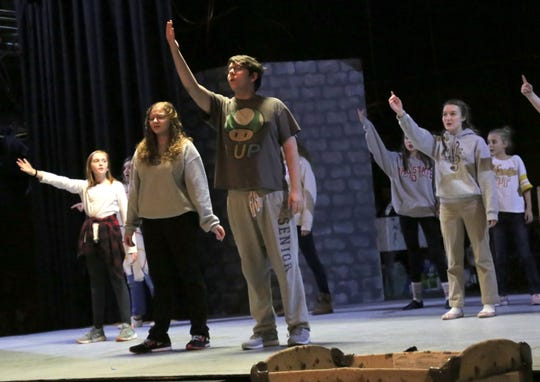 """Joshua Carpenter plays Buddy the elf during a rehearsal of the Mansfield Community Playhouse production of """"Elf Jr."""""""