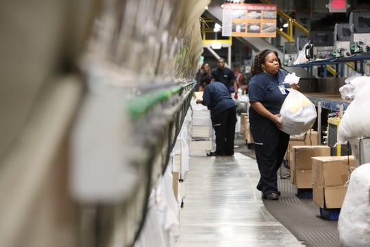 Employees sort packages inside FedEx's superhub at the Memphis International Airport on Nov. 20, 2018.