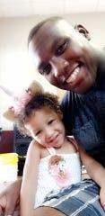 Memphis defensive lineman Emmanuel Cooper and his daughter, Olivia