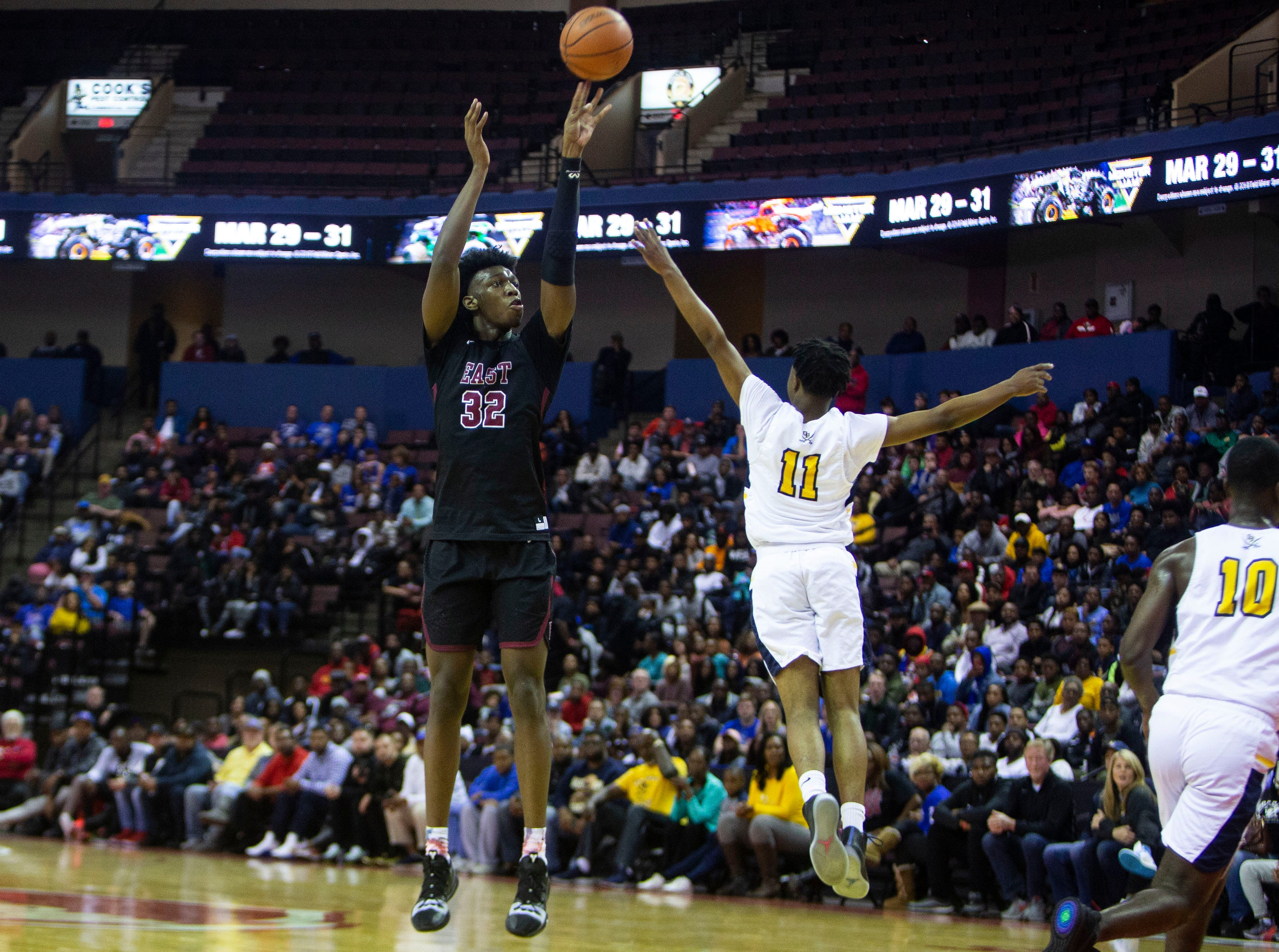 East Memphis Mustangs forward James Wiseman (32) shoots over Olive Branch Conquistadors guards Kyron Pleas (11) in the first half during a game Tuesday, Nov. 20, 2018 at the Landers Center in Southaven, Miss.