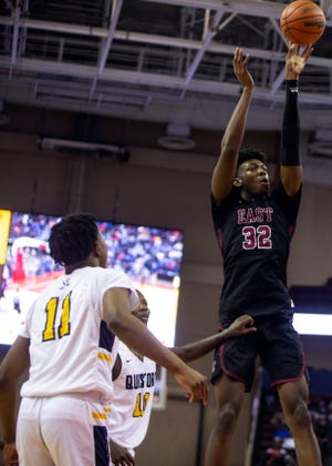 East Memphis Mustangs forward James Wiseman (32) shoots over Olive Branch Conquistadors guards in the first half during a game Tuesday, Nov. 20, 2018. at the Landers Center in Southaven Miss.