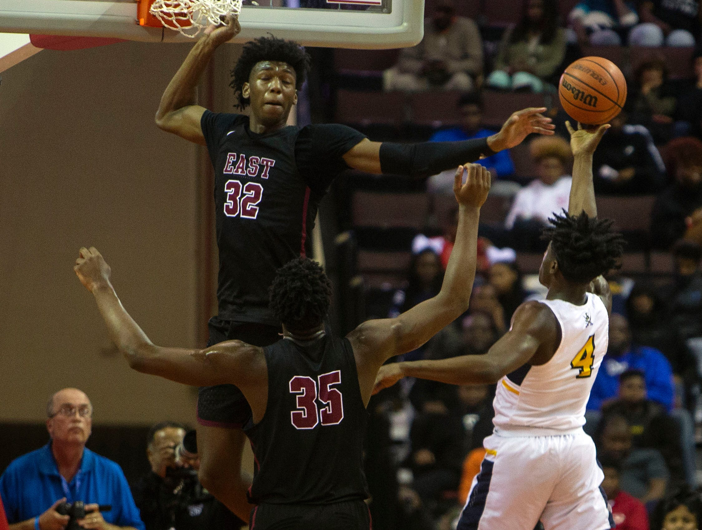 East Memphis Mustangs forward James Wiseman (32) blocks a shot attempt by  Olive Branch Conquistadors forward Cameron Matthews (4) during the first half of the Mid-South Basketball Classic basketball game Tuesday, Nov. 20, 2018, in Southaven, Miss.