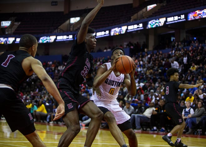 Olive Branch Conquistadors guards DJ Jeffries (0)shoots over East Memphis Mustangs forward James Wiseman (32) during the second half of the Mid-South Basketball Classic basketball game in Southaven,Miss., Tuesday, Nov. 20, 2018.