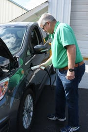 Tim Gorman connects a vehicle to the charger and Gorman's Auto Service on Marco Island.