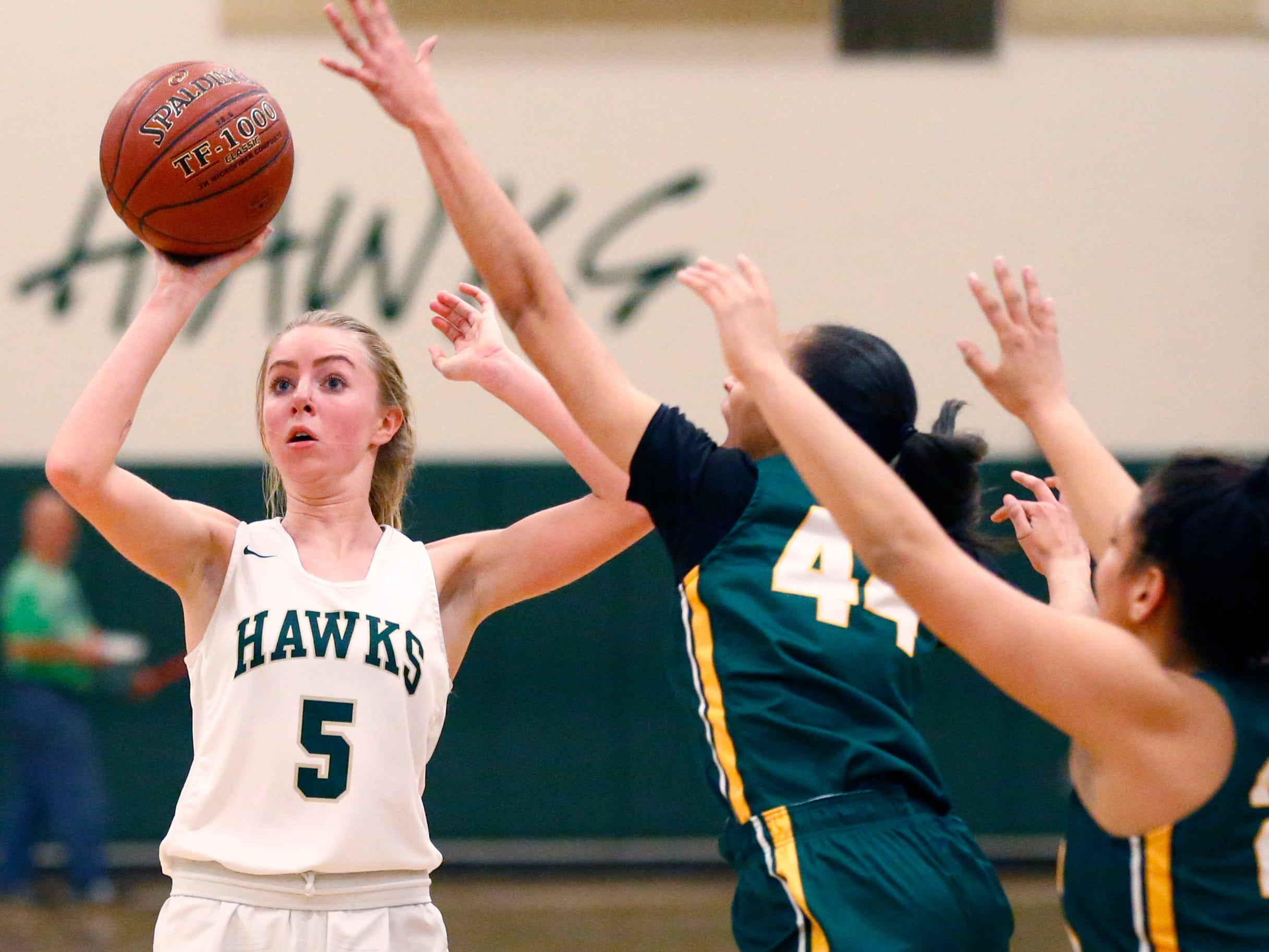 Greenfield's Emma Graetz fires from three-point range against Martin Luther at Greenfield on Nov. 20.