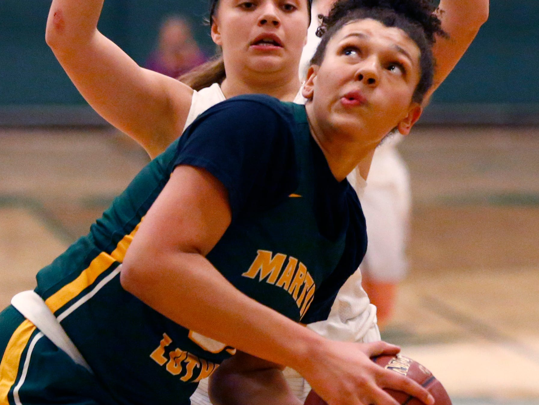 Martin Luther's Sydney Burris eyes the basket at Greenfield on Nov. 20.