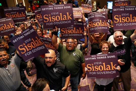 Supporters of Clark County Commission Chair and Democratic gubernatorial candidate Steve Sisolak cheer at an election night party.