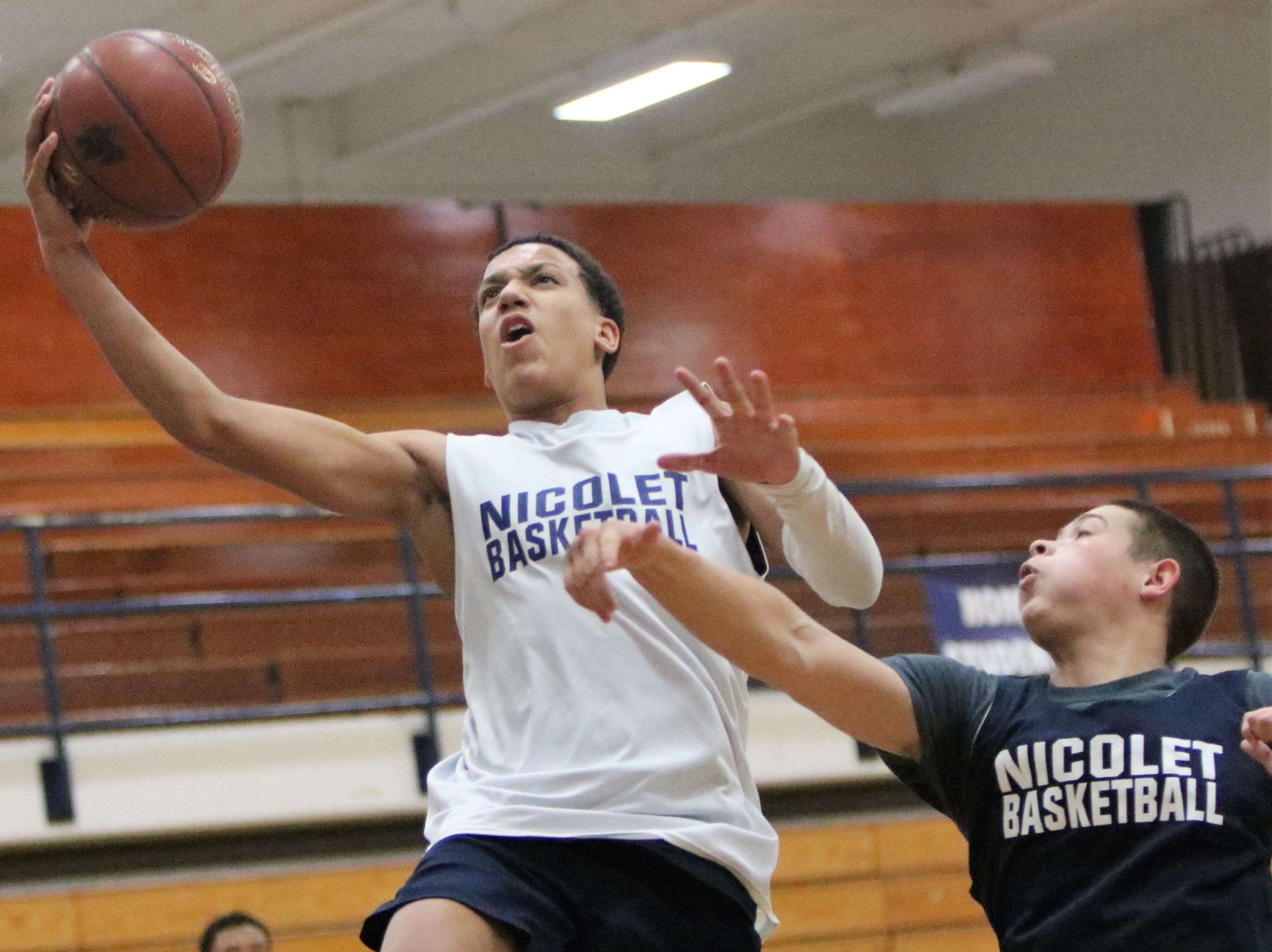 Nicolet's Kobe Johnson rises up for a layup over Sonny Phinisee during practice on Nov. 19. Johnson, along with his older brother, Jalen, transferred from Sun Prairie at the beginning of the school year.