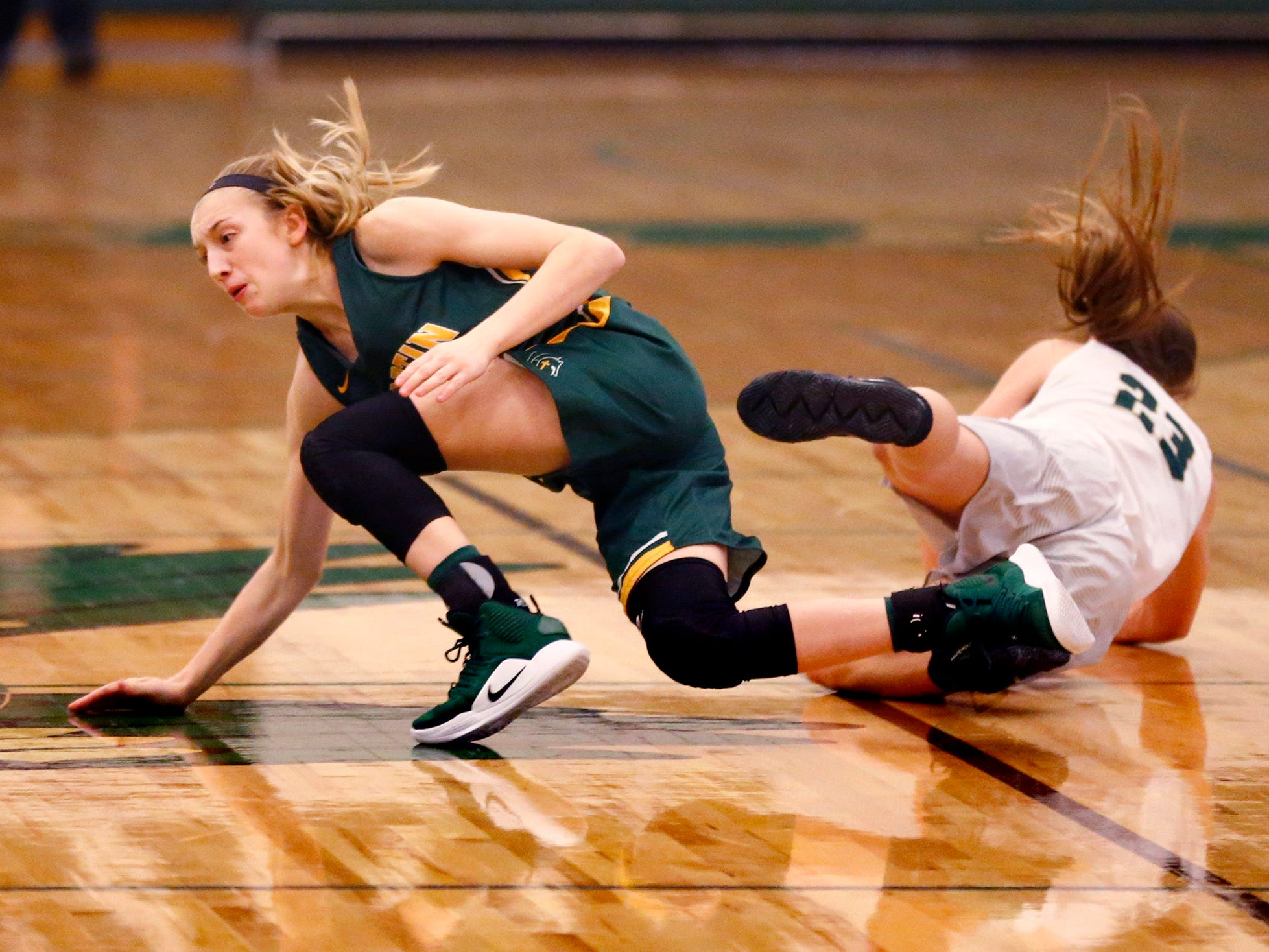 Martin Luther's Marianna Brick and Greenfield's Abby Polachek collide at Greenfield on Nov. 20.