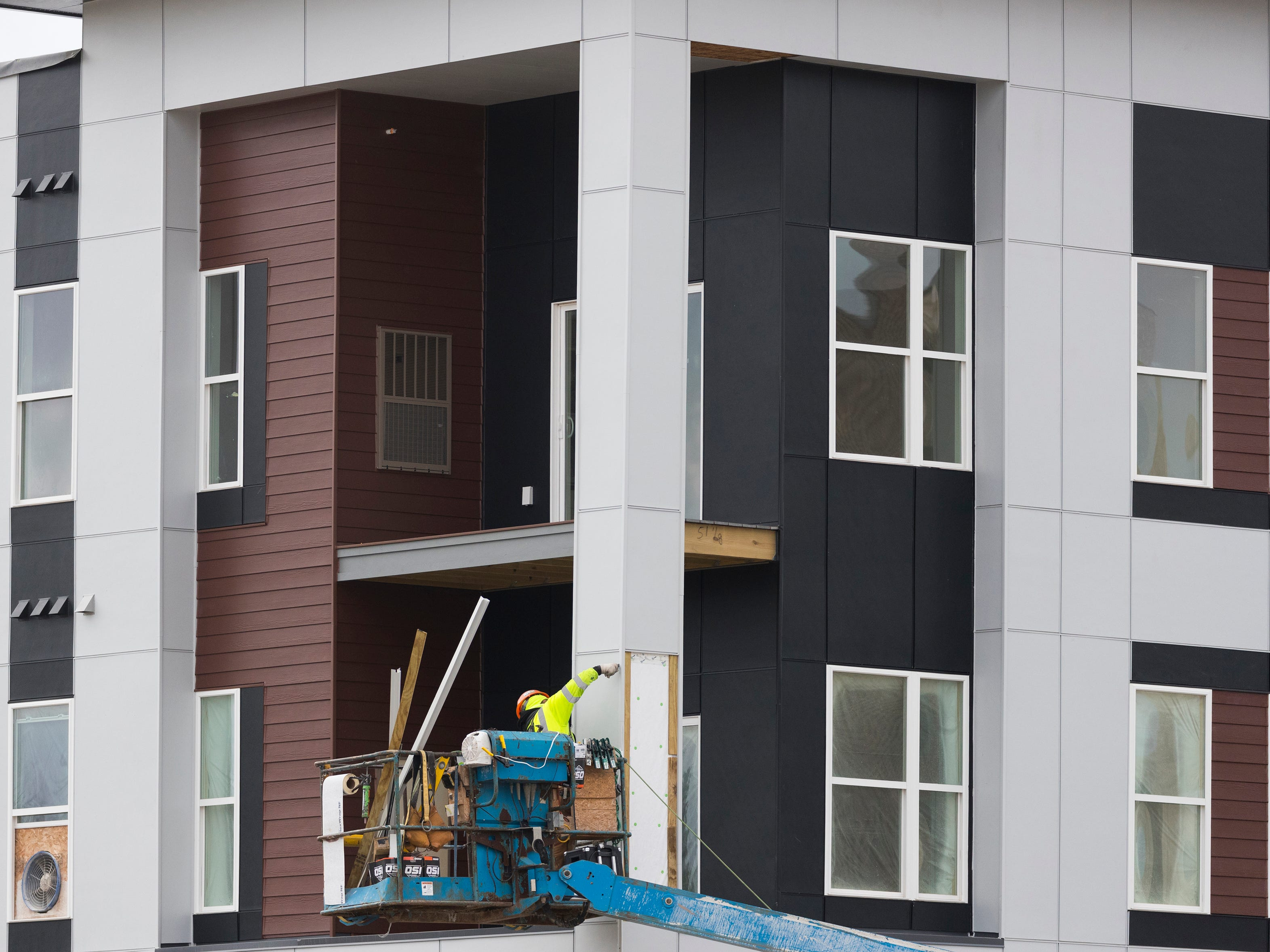 Exterior work continues on apartments at the 48-acre mixed development 84 South.