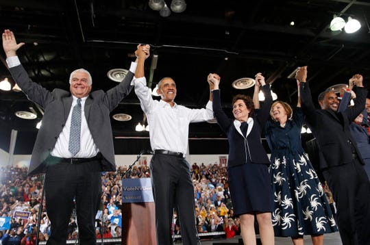 Former President Barack Obama, second from left, cheers at a rally in support of Clark County Commission Chair and Democratic gubernatorial candidate Steve Sisolak (left).
