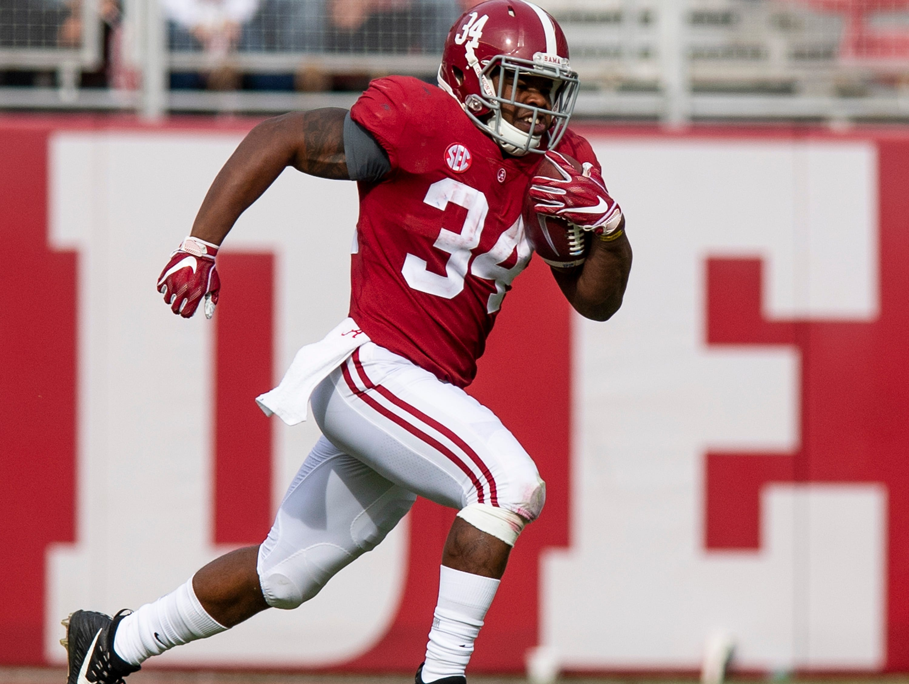 Alabama running back Damien Harris (34) carries the ball in second half against The Citadel action at Bryant-Denny Stadium in Tuscaloosa, Ala., on Saturday November 17, 2018.