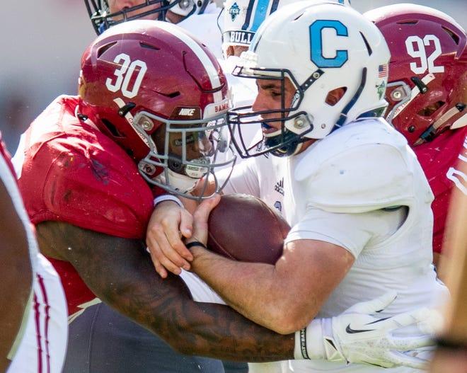 Alabama linebacker Mack Wilson (30) stops Citadel quarterback Brandon Rainey (16) In first half action at Bryant-Denny Stadium in Tuscaloosa, Ala., on Saturday November 17, 2018.