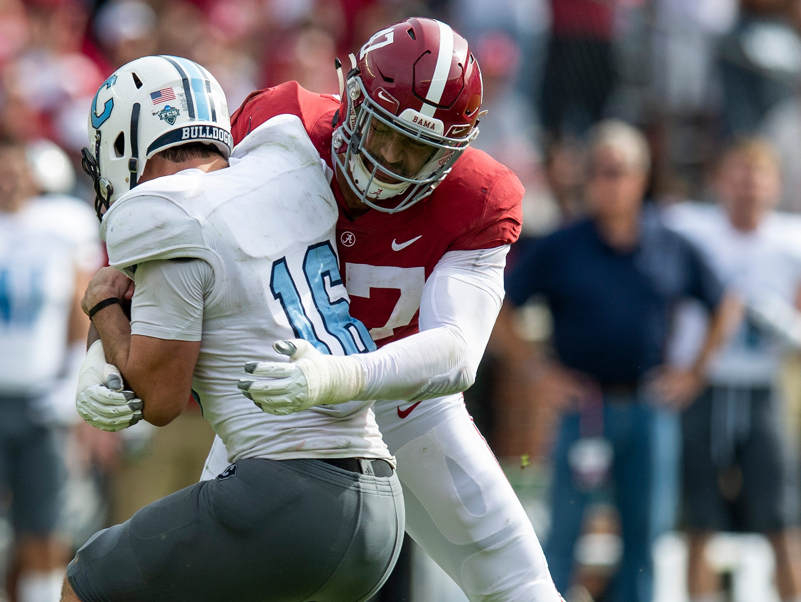 Alabama linebacker Christian Miller (47) wraps up Citadel quarterback Brandon Rainey (16) in second half action at Bryant-Denny Stadium in Tuscaloosa, Ala., on Saturday November 17, 2018.