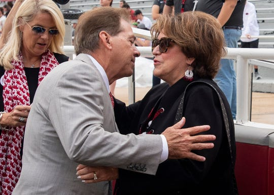 Alabama head coach Nick Saban kisses his wife Terry Saban before the Alabama vs. Arkansas game in Fayetteville, Ark., on Saturday October 6, 2018.