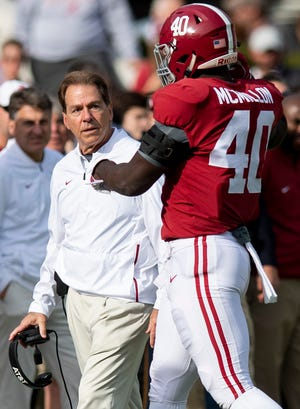 Alabama head coach Nick Saban talks with Alabama linebacker Joshua McMillon (40) after a penalty in second half action against The Citadel at Bryant-Denny Stadium in Tuscaloosa, Ala., on Saturday November 17, 2018.