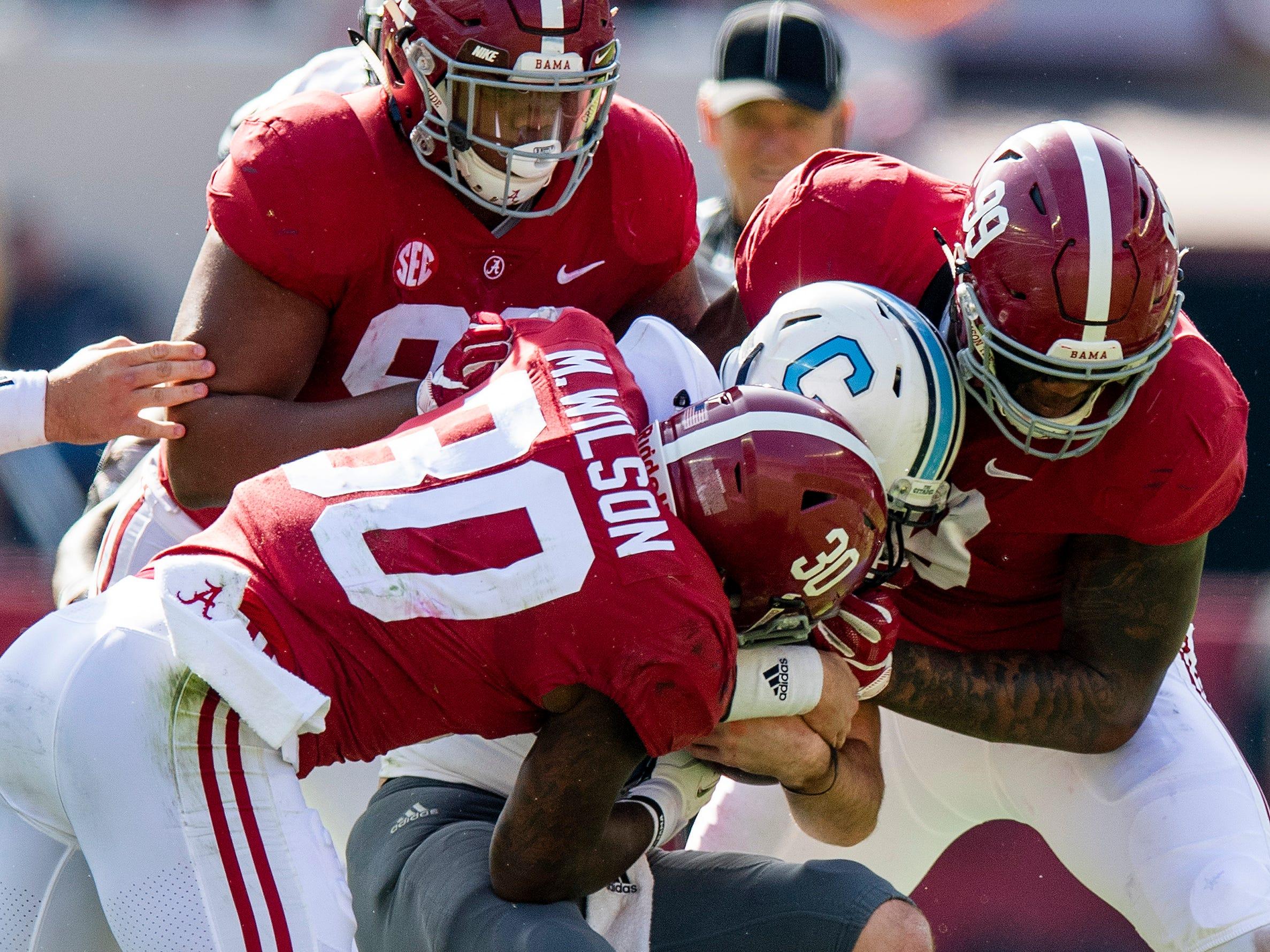 Alabama linebacker Mack Wilson (30) and defensive lineman Raekwon Davis (99) and defensive lineman Quinnen Williams (92) sack Citadel quarterback Brandon Rainey (16) In first half action at Bryant-Denny Stadium in Tuscaloosa, Ala., on Saturday November 17, 2018.