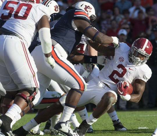 Alabama running back Derrick Henry (2) dives for yardage against Auburn during the Iron Bowl at Jordan-Hare Stadium in Auburn, Ala. on Saturday November 28, 2015. (Mickey Welsh / Montgomery Advertiser)