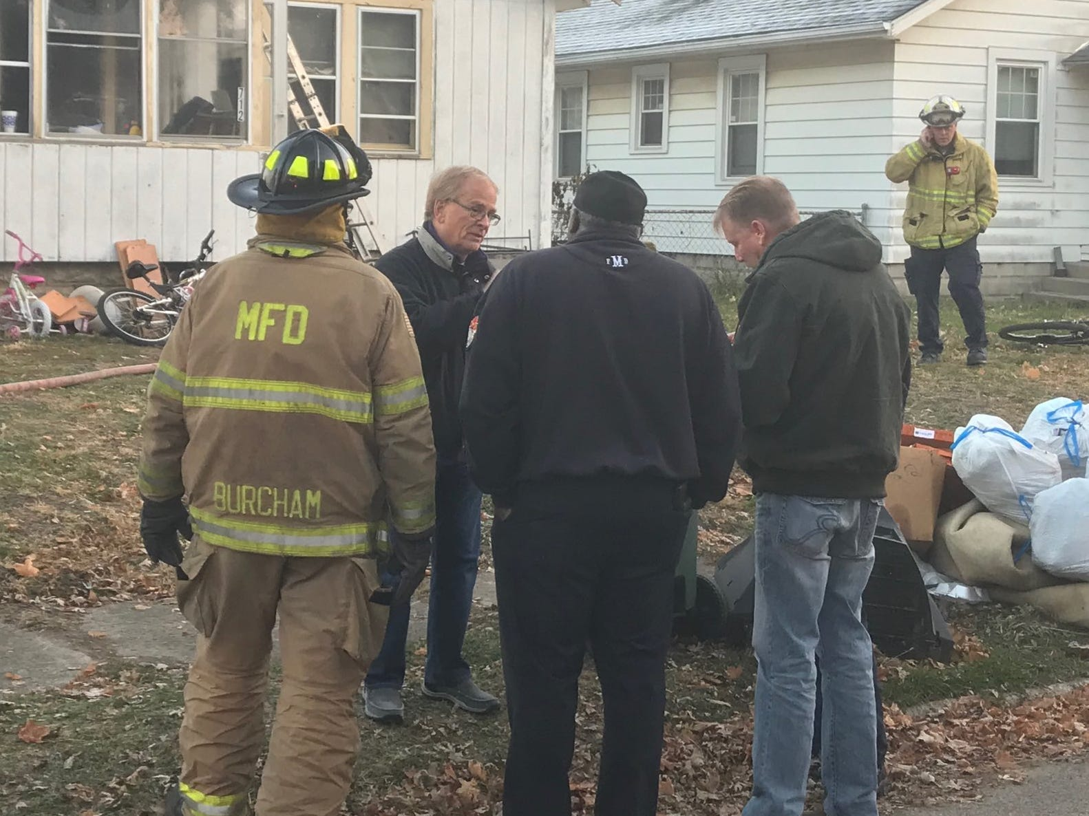 Muncie Mayor Dennis Tyler speaks to fire department officials at the scene of Wednesday's fatal fire.