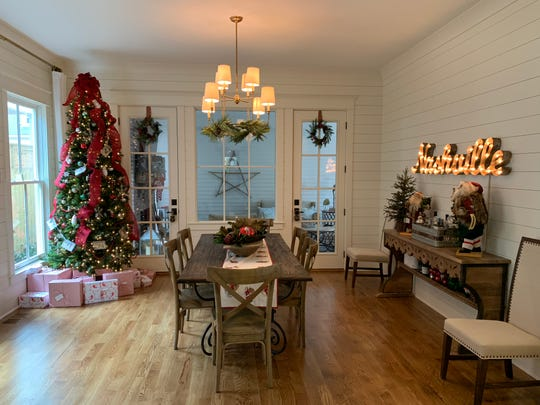 When staging a home during the holidays, local Realtor Holly Hockaday recommends keeping the tree small and the presents to a minimum so onlookers can see your home, not just your decorations.