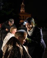 Caroline Lindner of Nashville Street Barbers gives Timothy Donahoe a hair cut on War Memorial Plaza Monday, Nov. 19, 2018, in Nashville, Tenn.