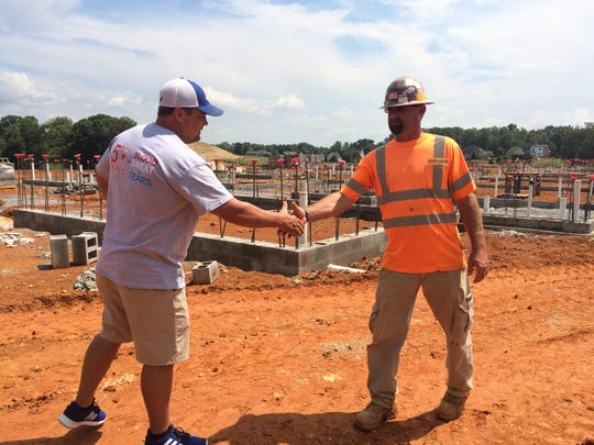 Pictured, from left, Burns Mayor Landon Mathis meets Josh Littleton, of Dickson, the superintendent for Burns Middle School construction project.