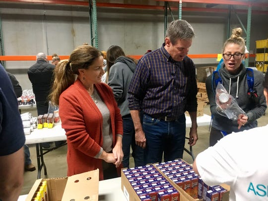 Gov.-elect Bill Lee and his wife, Maria, left, volunteer Nov. 21, 2018, at Second Harvest Food Bank in Nashville.
