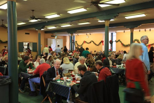 The Downtown Presbyterian Waffle Shop has attracted a crowd for a waffle lunch fundraiser the first Thursday of December since 1925.
