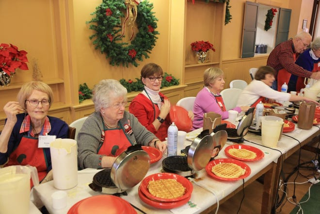"Church volunteers, manning two dozen waffle irons, make signature waffles from a ""secret"" recipe that has been used for all 93 years of the Waffle Shop."