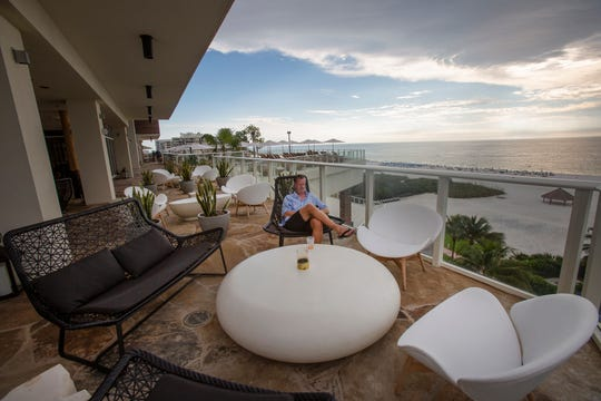 LR Marryott of Marco Island relaxes on the deck at Tesoro at JW Marriott Marco Island Beach Resort on Tuesday, Nov. 20, 2018.