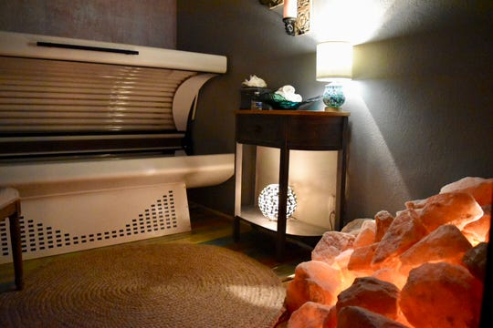 Salt Therapy Grotto & Spa in Naples uses photo rejuvenation with red light technology inside this red light therapy bed to trigger a body's production of collagen and create more youthful, glowing skin.