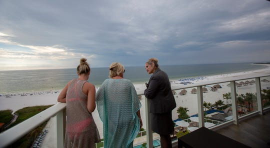 Jennifer Moore, left, and her mother, Nancy Moore, both from Boston, talk with Amanda Cox, director of sales and marketing at JW Marriott Marco Island Beach Resort, while taking in the view from the balcony of a corner suite at the resort's new Lanai Tower on Tuesday, Nov. 20, 2018.