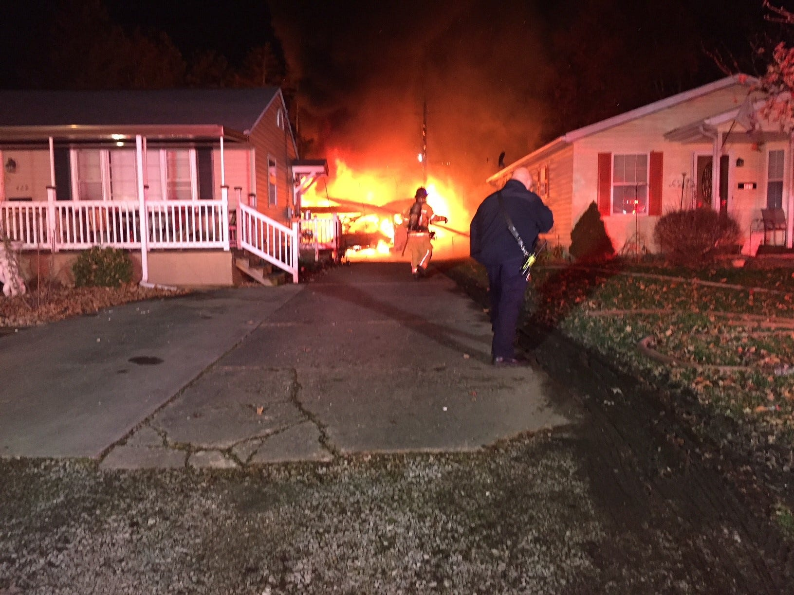 Newark firefighters battle a garage fire on 429 Sherwood Dr. West around 2 a.m. Wednesday. One occupant was taken to Licking Memorial Hospital.