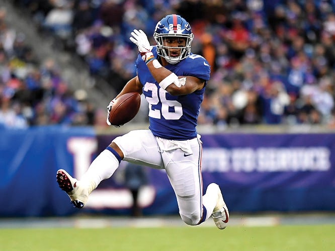 New York Giants running back Saquon Barkley (26) rushes against the Tampa Bay Buccaneers in the second half. The Giants defeat the Buccaneers 38-35 on Sunday, Nov. 18, 2018 in East Rutherford. (Danielle Parhizkaran/@danielleparhiz)